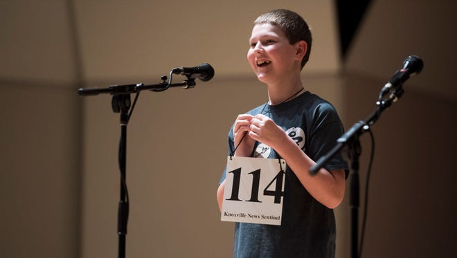 Jared Mueller, 11, smiles as he wins the News Sentinel Southern Appalachia Regional Spelling Bee for correctly spelling the word Talmud on Saturday, March 17, 2018.
