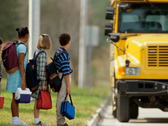 School children standing in line outside the school