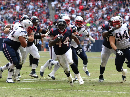 Houston Texans running back Ben Tate (44) runs with the ball for a fourth quarter touchdown against the New England Patriots.