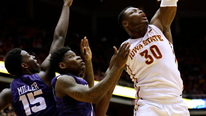 Iowa State guard Deonte Burton (30) dunks the ball over TCU's JD Miller, left, and Chauncey Collins, center, during the first half of an NCAA college basketball game, Saturday, Feb. 20, 2016, in Ames, Iowa.