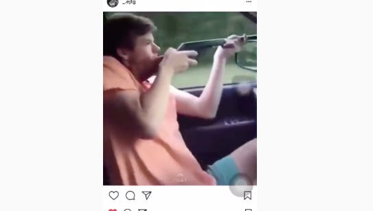 A screenshot of an Instagram video that shows a Chiles High School student driving, shooting a BB gun and shouting racial slurs.