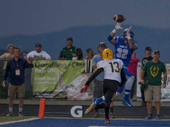 McQueen's Alec Crosby brings down a pass in the endzone for a touchdown in their football game against Manogue played at McQueen  on Sept. 1.