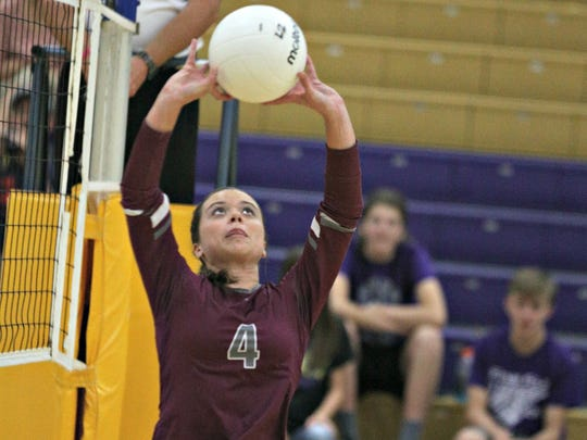 Eagleville's Abby Creech sets the ball during Tuesday's 9-A title match against MTCS.