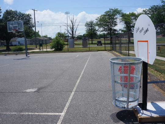 A new trash receptacle at the basketball courts at