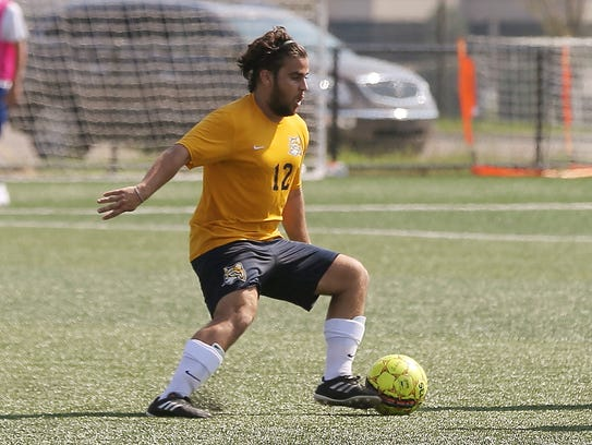 Dribbling the ball during a recent game is Schoolcraft