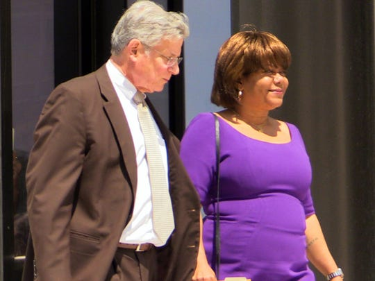 Former Spring Valley Mayor Noramie Jasmin exits the U.S. Courthouse in White Plains Aug. 7, 2015 after receiving a four year sentence. With her is her attorney Benjamin Ostrer.