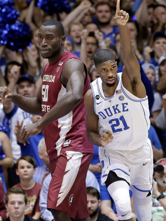 Duke's Amile Jefferson (21) reacts following a basket, next to Florida State's Michael Ojo (50) during the first half of an NCAA college basketball game in Durham, N.C., Tuesday, Feb. 28, 2017. Duke won 75-70. (AP Photo/Gerry Broome)