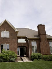 """The Belanger family bought a new home in Carmel. """"Carmel is a great community with great amenities,"""" Stacia Belanger said. """"We also looked at Zionsville and Westfield, but this house really caught our eye."""""""