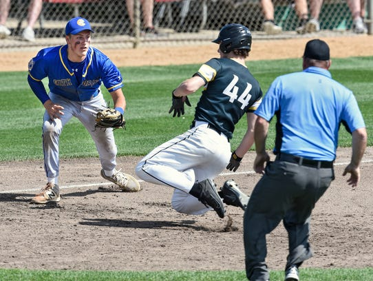 Cathedral's Tyler Bautch prepares to tag Carter Sulluvan of Duluth Marshall during the state Class 2A quarterfinals Thursday, June 14, at Dick Putz Field in St. Cloud.