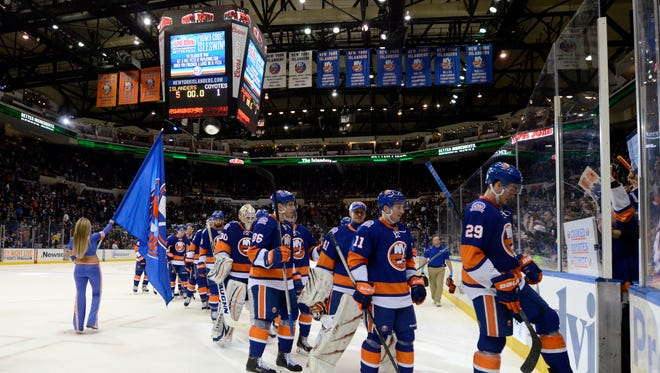 The New York Islanders leave the ice after defeating the Arizona Coyotes 5-1 at Nassau Coliseum in February.