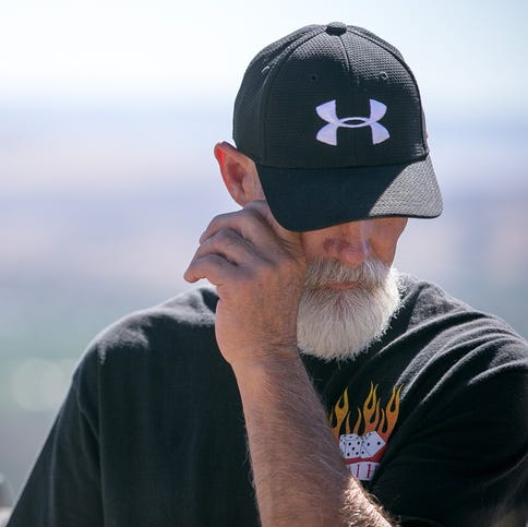 "Former Fuels Management Supervisor Todd Rhines wipes away tears as he tells the story of ""his boys,"" the Granite Mountain Hotshots, near the summit of Thumb Butte in Prescott on Monday, June 30, 2014."