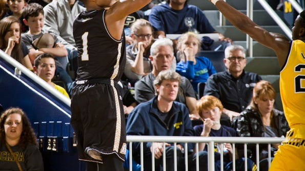 Bryant guard Hunter Ware (1) takes a 3-point shot in the second half of an NCAA college basketball game against Michigan at Crisler Center in Ann Arbor, Mich., Wednesday, Dec. 23, 2015.  (AP Photo/Tony Ding)