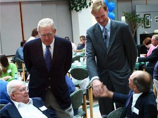 Legendary Corning Inc. researcher S. Donald Stookey, left, seated, introduces his son Donald, right, to Wendell P. Weeks, Corning Inc.'s chairman and chief executive officer, and Joseph Miller, Corning's chief technical officer, during the 2008 Legends Garden dedication at Sullivan Park.