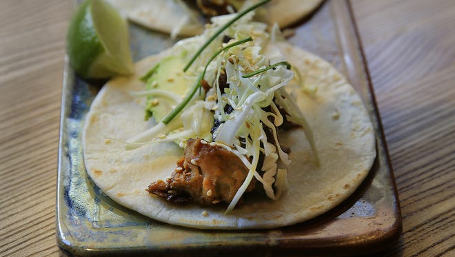 Señor Mu Shu  tacos at Nada hold ginger-braised pork, sesame, ancho hoison, lime, cabbage and avocado.