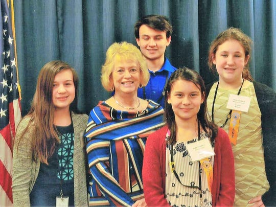 Government Experience –  Jacob, Abigail, Analiese Garza and Margaret Lawrence acted as pages for Senator Becker late February. They learned about Indiana state government and toured the statehouse. In the photo are Abigail, Senator Becker, Analiese, Margaret and Jacob.