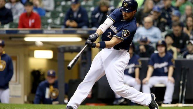 Travis Shaw hits a home run in the first inning against the Cardinals at Miller Park.