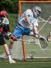 South Burlington goalie  Ryan Hockenbury  attempts to make a save during last year's Division I high school boys lacrosse semifinals.