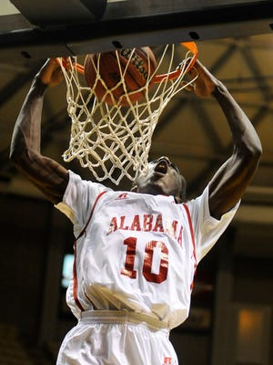 G.W. Carver star Brandon Austin dunks during Friday's Alabama-Mississippi Basketball All-Star Game at the Acadome on Friday. Austin led the Alabama All-Stars with 16 points.