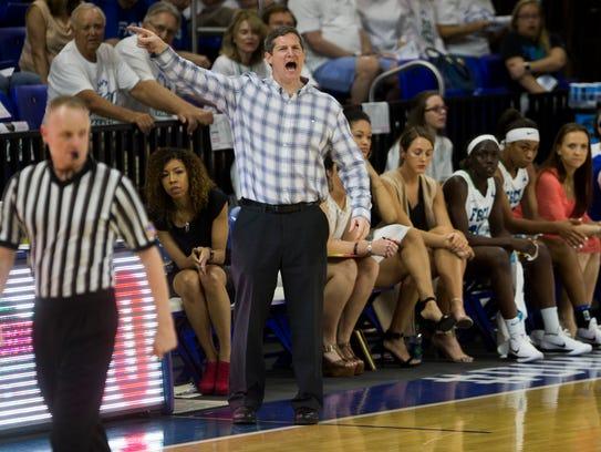 FGCU women's basketball head coach Karl Smesko directs