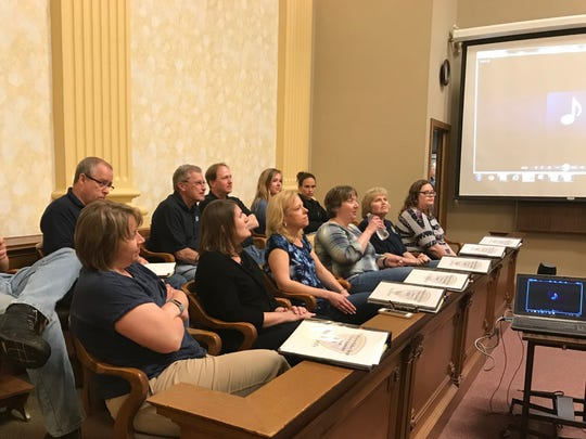 Citizen Academy students sit in a jury box at the Manitowoc County Courthouse during their last class of the series with the Manitowoc Police Department May 15.