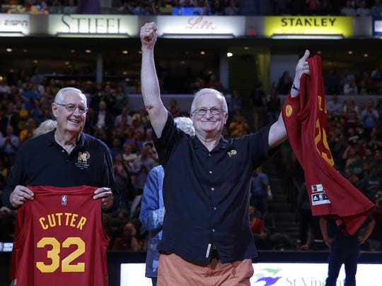 Bobby Plump of the Milan High School 1954 state championship team, along with other members of the team, is honored during halftime of the Indiana Pacers versus Boston Celtics game at Bankers Life Fieldhouse in Indianapolis on March 15, 2016.