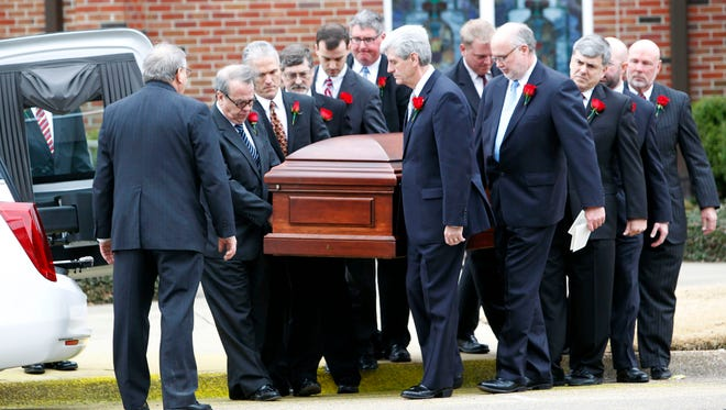 Gov. Phil Bryant, center, and the rest of the pallbearers carry the casket of Rep. Alan Nunnelee following the funeral ceremony on Monday, Feb. 9, 2015, at Calvary Baptist Church in Tupelo, Miss. More than 1,200 people packed the church to remember the third-term Republican congressman who died of a brain tumor Friday. He was 56.