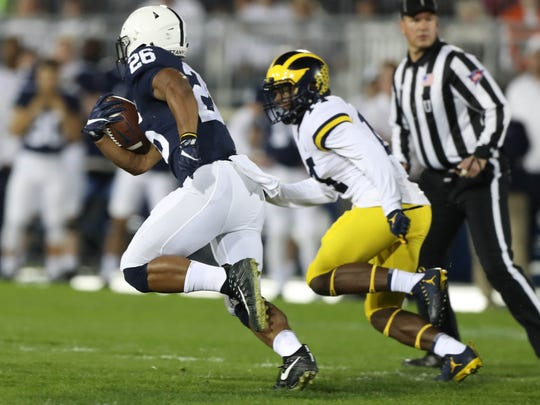 Michigan's Josh Metellus pursues Penn State's Saquon Barkley in the first half on Saturday, October 21, 2017 at Beaver Stadium in University Park, Pa.