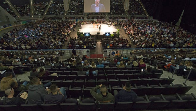 Hundreds of people gather at the Pensacola Bay Center on Jan. 25, 2015, to hear motivational speaker John C. Maxwell.
