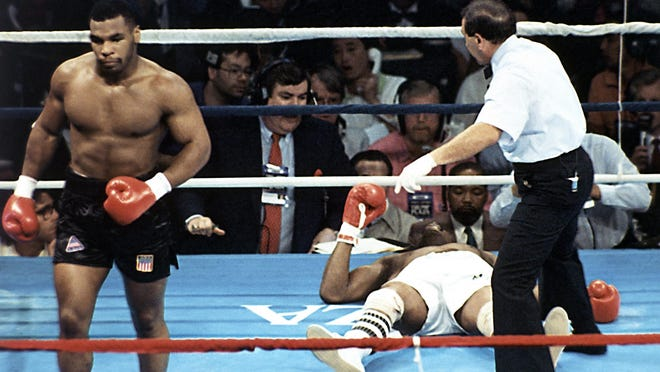 Michael Spinks is seen as he goes down after receiving a knockout by Mike Tyson during their 91-second heavyweight fight, June 27, 1988, at Trump Plaza in Atlantic City.