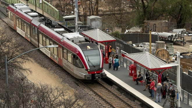 A commuter train stops at the Capital MetroRail temporary downtown station in January. Voters are being asked to approve a major tax hike for a major expansion of transit in Austin.