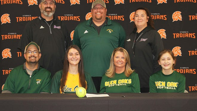 Kiley Weiderman, pictured front between parents Matt and Jody, will continue her academic and softball careers with Glen Oaks. Also pictured are sister McKenna (front), travel coach Eric Lewis, Glen Oaks coach Kevin Lewis and travel coach Amy Lewis.