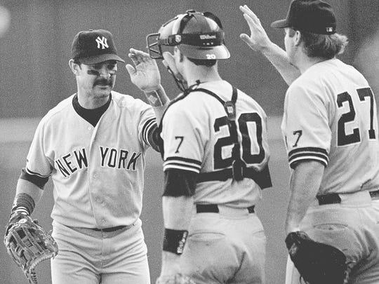 Don Mattingly, left, celebrates with Yankees teammates in 1995.