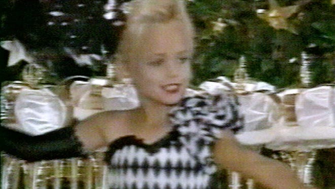 This file image made from an undated family video shows JonBenet Ramsey performing during a beauty pageant. Citing new DNA tests, prosecutors on Wednesday, July 8, 2008, cleared JonBenet Ramsey's parents and brother in the 1996 killing of the 6-year-old beauty queen and apologized to the family for casting the cloud of suspicion that hung over them for more than a decade.