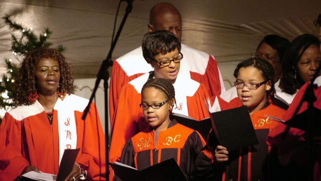 Shiloh Missionary Baptist Church is celebrating its 100th anniversary. Here, members of the church choir sing during the Victorian Christmas Open House Saturday, Dec. 11, 2010, at Davis-Shai House in Heath.