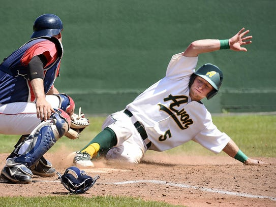 Avon's Carter Holthaus slides safely into home in front