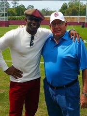 NFL Hall of Famer Deion Sanders poses with former FSU defensive coordinator on the Al Dunlap practice fields on Wednesday afternoon.