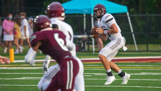 Quarterback Holden Geriner looks to throw the ball  during the Benedictine Maroon/White scrimmage Friday.
