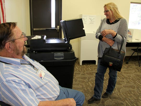 Jane Lester laughed with an election official after