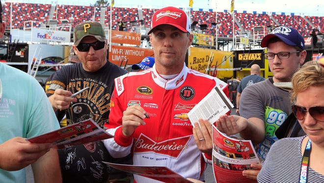 Kevin Harvick signs autographs prior to practice for the CampingWorld.com 500 at Talladega Superspeedway.