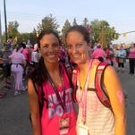 From left, Carol Ellis of Farmington Hills, with her sister, Jacquelyn Robinson of Detroit, at the Susan G. Komen 3-Day opening ceremony in the parking lot of the Suburban Collection Showplace in Novi. Both are breast cancer survivors.