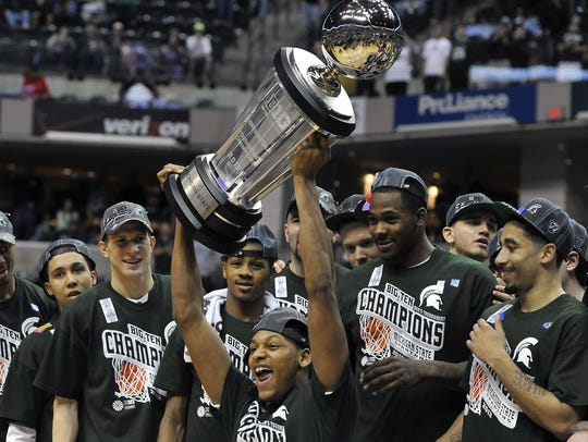 MSU's Adreian Payne screams as he raises the Big Ten