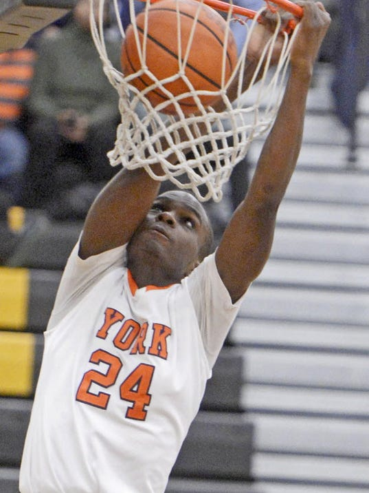 William Penn's Tavon Parker dunks during the YAIAA boys' basketball tournament at Red Lion Area High School on Saturday, Feb. 9, 2013. William Penn beat Bermudian Springs, 60-38. (DAILY RECORD/SUNDAY NEWS - KATE PENN)