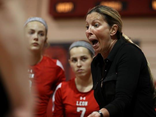 Leon Head Coach Angie Strickland talks to her team