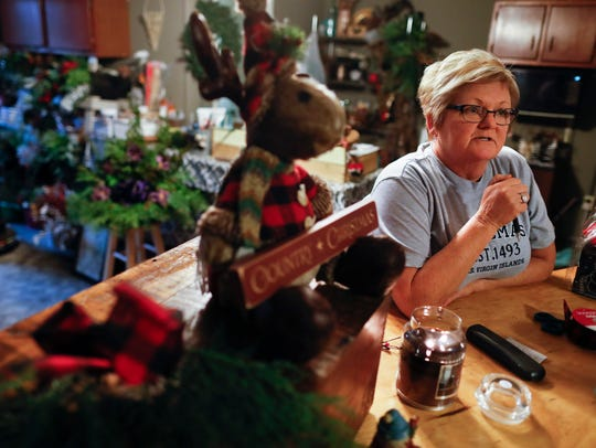 Corning native Susan Hern leans on the shop counter