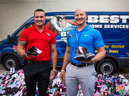 Brothers and Best Home Services co-owners Keegan and Chadd Hodges pose for a portrait with donated shoes collected from a recent shoe drive for Laces of Love outside of their store in Naples on Monday, June 11, 2018.