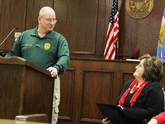 Jackson Police Capt. Mike Holt thanks retired Sgt. Debbie Stanfill for her work with domestic violence victims during her 35-year career at a retirement reception for Stanfill on Friday.