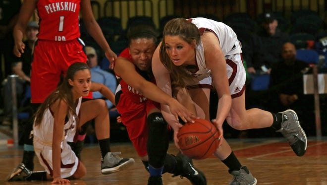 Mairead Durkin (1) of Albertus Magnus and Peekskill's Aubrey Dabbs (5) battle for loose ball during the Class A girls basketball final at the Westchester County Center in White Plains March 2, 2015. Albertus Magnus defeated Peekskill 56-49.