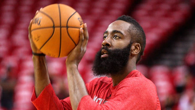 Houston Rockets guard James Harden (13) warms up before Game 2 against the Portland Trail Blazers during the first round of the 2014 NBA Playoffs at Toyota Center.