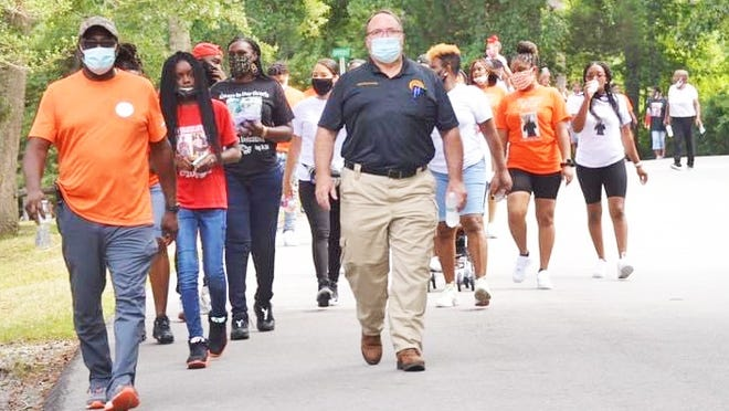 Dozens of people gathered for the No More Silence End Gun Violence Walk on August 1.