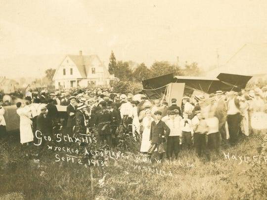 Period postcard showing the wreckage of George Schmitt's airplane near the Rutland Fairgrounds in 1913. Schmitt was an early American aviator and the first to die in a crash in Vermont.